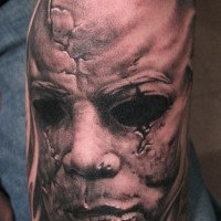 Classic horror tattoo on arm by paul booth