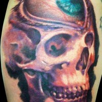Surreal watercolor skull tattoo with eye