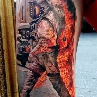 Colored amazing looking arm tattoo of burning astronaut