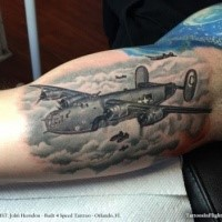 Colored amazing looking biceps tattoo of WW2 bomber planes