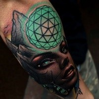 Colored amazing looking forearm tattoo of of mystic woman with magical orb