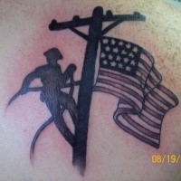 Colored American native scapular tattoo of lineman with flag