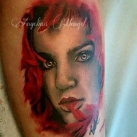 Colored arm tattoo of mystical woman face with red hair