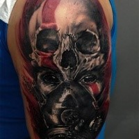 Colored creepy looking shoulder tattoo of tribal woman with gas mask