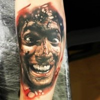 Colored horror style bloody arm tattoo of crazy man