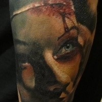 Colored horror style bloody nurse tattoo on forearm