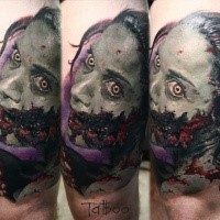 Colored horror style colored thigh tattoo of bloody zombie woman with knife