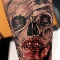 Colored horror style creepy looking arm tattoo of monster face with bloody face