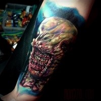 Colored horror style creepy looking arm tattoo of bloody monster