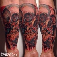 Colored horror style creepy looking forearm tattoo of human skull and heart