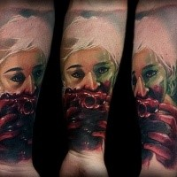 Colored horror style creepy looking forearm tattoo of bloody woman with heart