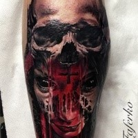 Colored horror style creepy looking leg tattoo of bloody demon with human skull