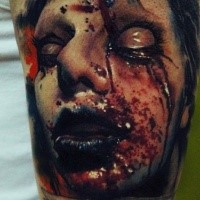 Colored horror style creepy looking tattoo of bloody humans face