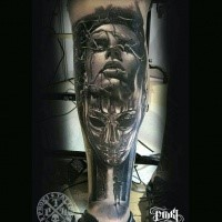 Colored horror style detailed leg tattoo of woman face with vine and mask