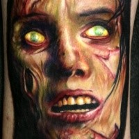 Colored horror style detailed zombie face tattoo on leg