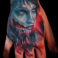 Colored horror style hand tattoo of zombie woman portrait