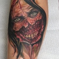 Colored horror style impressive looking zombie woman face tattoo