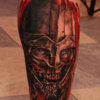 Colored horror style incredible looking leg tattoo of zombie warrior with helmet