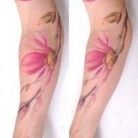 Colored illustrative style arm tattoo of pink flower