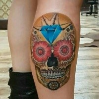 Colored Mexican style leg tattoo of human skull with diamond and flowers