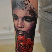 Colored new school style forearm tattoo of vampire woman with rose