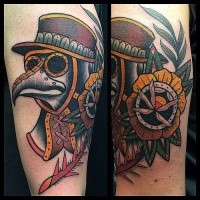 Colored old school style arm tattoo of plague doctors mask with rose