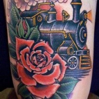 Colored old school style steaming train with big red rose tattoo on arm