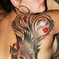 Colored phoenix tattoo on shoulder blade