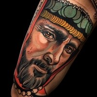 Colored realistic looking arm tattoo of sad man face