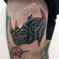 Colored small old school thigh tattoo of rhino head