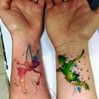 Colored wrist tattoo of watercolor Tinkerbell's