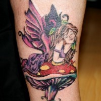 Colorful fairy lying on mushroom tattoo