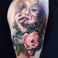Colorful illustrative style tattoo of seductive woman with wildflowers