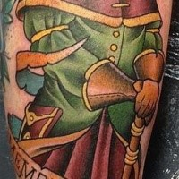 Colorful interesting looking arm tattoo of man in plague doctors mask and lettering