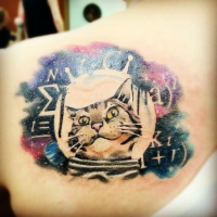 Colorful interesting looking scapular tattoo of scientific cat with lettering