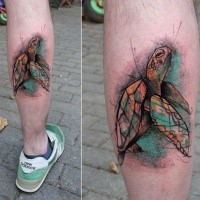 Colorful leg muscle tattoo of swimming turtle
