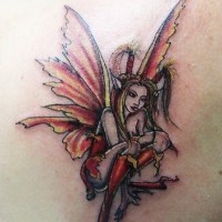 Colorful little fairy tattoo