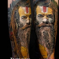 Colorful portrait of man tattoo by Jurgis Mikalauskas