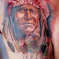 Colorful portrait of native american tattoo on chest