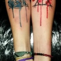 Colorful sacred symbols forearm tattoo