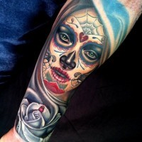 Colorful santa muerte girl with white rose with drop of blood forearm tattoo by Nikko Hurtado