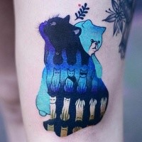 Colorful surrealism style thigh tattoo of cats by Joanna Swirska