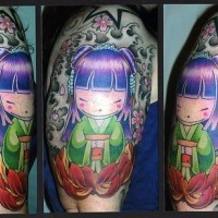 Colorful tattoo on hand with chinese girl and lotos