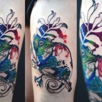 Colorful well painted by Joanna Swirska thigh tattoo of chameleon