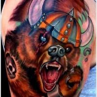 Coloured bear in viking helmet tattoo on shoulder