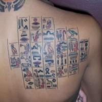 Coloured egyptian hieroglyphs tattoo on back