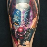 Tatuaje  de payaso peligroso con arma