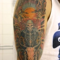 Coloured grim reaper with skeleton rider tattoo on shoulder