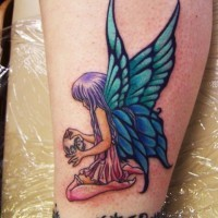 Coloured little fairy with skull tattoo