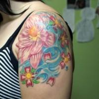 Coloured lotus tattoo on shoulder
